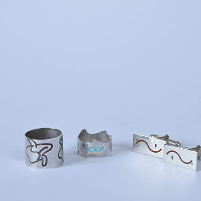 Silver and enamel rings and cufflinks