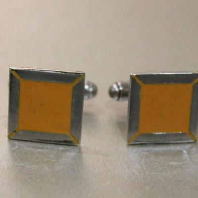 yellow cufflinks pair sharp image