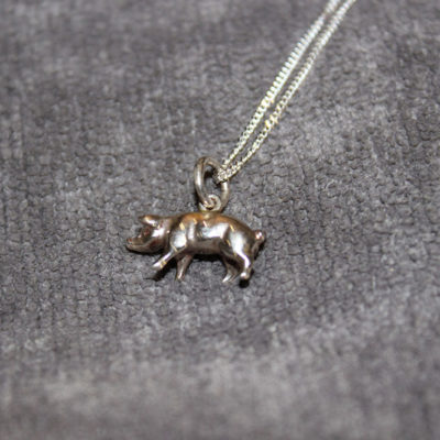 Silver cast pig on silver chain