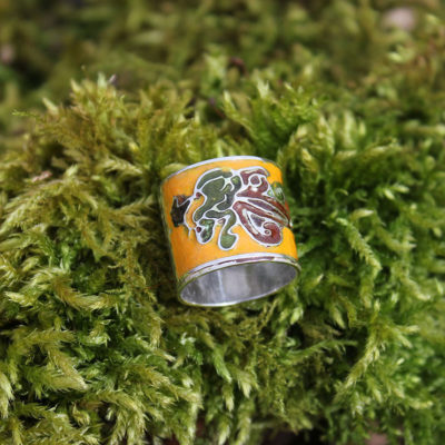 Yellow enamel ring on green moss